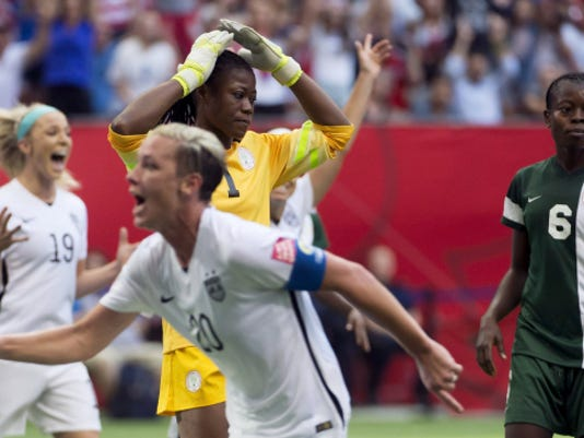 Nigeria goalkeeper Precious Dede reacts to being scored on by Abby Wambach during the first half of Tuesday's FIFA Women's World Cup soccer match in Vancouver, British Columbia. Wambach's goal gave the U.S. a 1-0 win and first place in Group D.