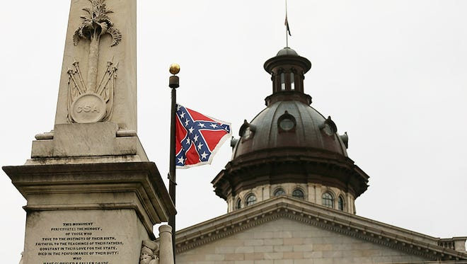 The Confederate flag flies on the Capitol grounds after South Carolina. Gov. Nikki Haley announced that she will call for the Confederate flag to be removed on June 22, 2015 in Columbia, SC.,.