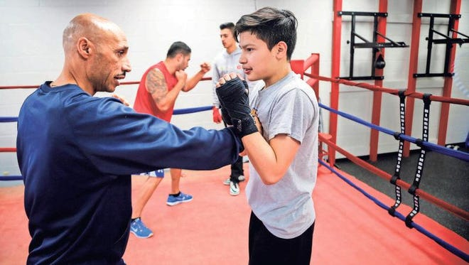 John Saunders, a police officer from Des Moines, Iowa, mentors youth through a boxing club.