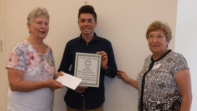 Chairman of Wekiva Youth Camp Cyndi Trossbach, left, and Garden Club of Stuart President Sandy Decker, right, present Outstanding Youth Award to Alex Leserra.