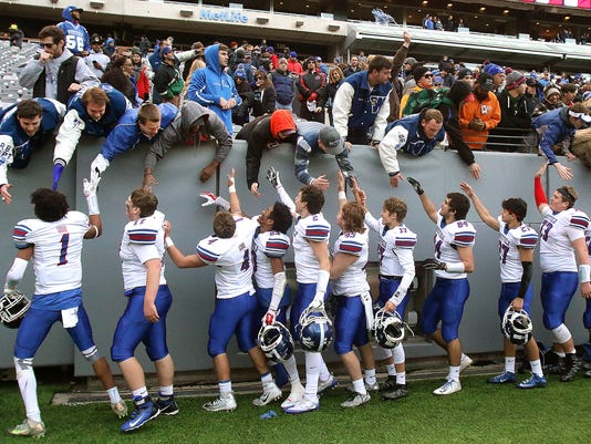 636398704216379756-Westfield-football-team-celebrates-with-its-fans-last-December-after-clinching-its-second-straight-North-2-Group-V-championship-at-MetLife-Stadium.jpg