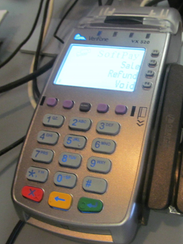 A credit card reader along with several other items