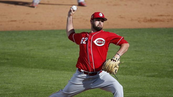 Reds relief pitcher Jackson Stephens delivers a pitch.