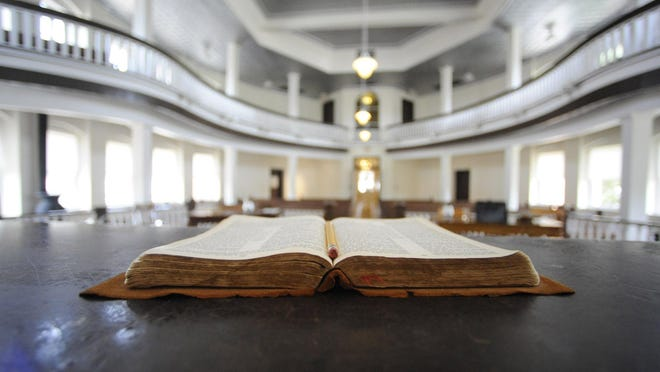 """A Bible sits open on the judge's desk in the old Monroe County Courthouse in Monroeville, Alabama. The courtroom was used as a model for the film adaptation of """"Mockingbird."""""""