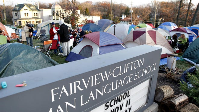 In 2011, tents fill the front yard of Fairview-Clifton German Language School as parents hold spots in line for enrollment.