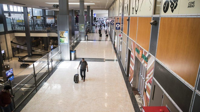 Very few travelers are making their way through the concourse at Austin-Bergstrom International Airport on Thursday. A 43% decline in passengers this fiscal year has delayed an expansion plan that would double the airport's capacity in the next five to 10 years.