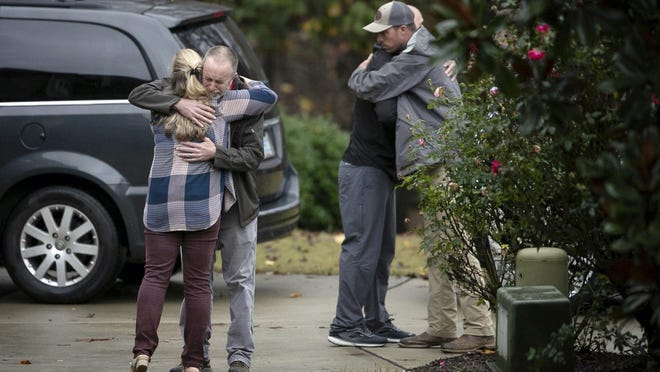 Neighbors console each other on Lord Granville Way in Rolesville, N.C. on Thursday afternoon November 12, 2020 after a neighborhood child drowned in a nearby creek.