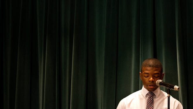 """Jheasong Clermond re-enacts the """"I Have a Dream"""" speech by Dr. Martin Luther King Jr. during a Black History Month presentation at Dunbar Community High School Friday morning (2/27/15). The presentation entitled, """"Moments in the 60's... A Period of Change: Black History Perspective,"""" included speech recitals, singing and dancing by both students and administrators. The program was put together by City of Palms and Palm Acres Charter High Schools."""