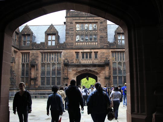 A group walks on a tour at Princeton University in Princeton.