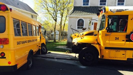 Two school buses were damaged in crash at Church and West streets in Spring Valley on Tuesday morning. The driver of larger private school bus (right) was issued summonses on April 29, 2015, including for not stopping at a stop sign and speeding.
