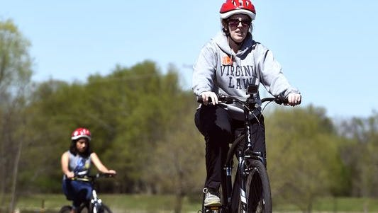 Adults learn to ride a bicycle through a free community course led by Walk Bike Nashville.