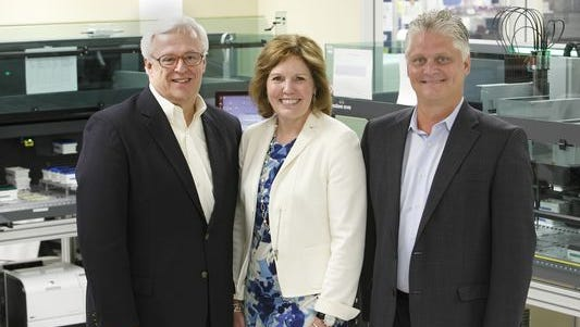 Jim Burns, Gina Drosos and Don Wright of Assurex Health.