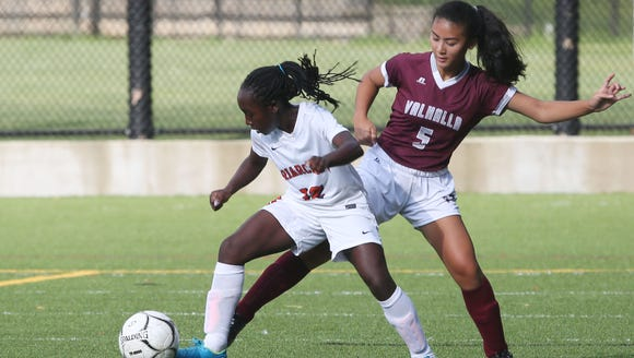 From left, Briarcliff's Muriel Oppong (12) moves the