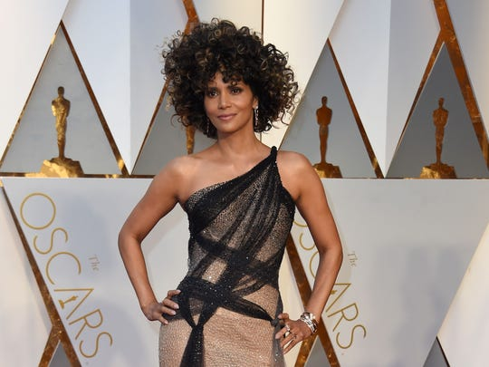 Halle Berry arrives on the red carpet for the 89th