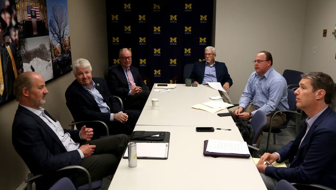 (L to R) University of Michigan Chief Investment Officer  L. Erik Lundberg, Executive Vice President and Chief Financial Officer Kevin Hegarty, Vice President for Development Jerry May and Assistant Vice President for Public Affairs Rick Fitzgerald talk with Detroit Free Press reporters David Jesse and Matthew Dolan this summer.