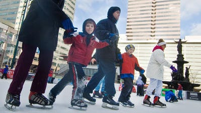 On Fountain Square, beginners to experienced skaters join together for a spin on the ice at the skating rink.