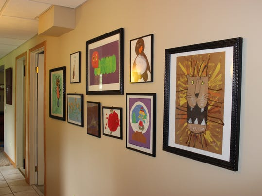 """Our """"Wall of Fame."""" It's just one of many ways to display artwork and school papers."""