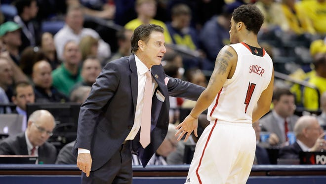 Louisville Cardinals coach Rick Pitino talks with Quentin Snider in the first round of the 2017 NCAA tournament at Bankers Life Fieldhouse on March 17, 2017 in Indianapolis.