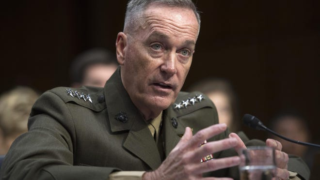 Then-Marine Corps Commandant Gen. Joseph Dunford Jr. testifies July 9 during his Senate Armed Services Committee confirmation hearing to become the Chairman of the Joint Chiefs of Staff, on Capitol Hill in Washington. The Marine Corps is expected to ask that women not be allowed to compete for several front-line combat jobs, inflaming tensions between Navy and Marine leaders, U.S. officials say. The tentative decision has ignited a debate over whether Navy Secretary Ray Mabus can veto any Marine Corps proposal to prohibit women from serving in certain infantry and reconnaissance positions. And it puts Dunford, the Marine Corps commandant who takes over soon as chairman of the Joint Chiefs of Staff, at odds with the other three military services, who are expected to open all of their combat jobs to women.