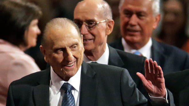 President Thomas S. Monson, of The Church of Jesus Christ of Latter-day Saints, waves to the audience during the opening session of the Mormon church conference Saturday, April 4, 2015, in Salt Lake City.