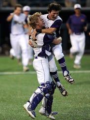 Wylie catcher Caleb Munton (25) celebrates with teammate