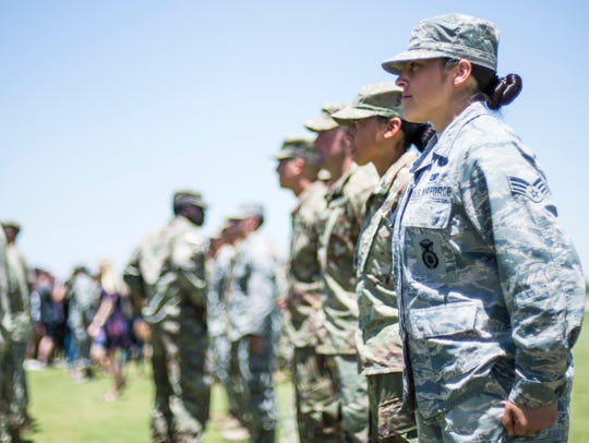 Senior Airman Lesley Trevizo stands at attention as