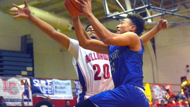 Chris Johnson goes in for a layup on Friday night against the Las Cruces High Bulldawgs in Las Cruces.