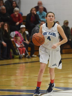 Pine Plains' Tia Fumasoli takes the ball up court during a game against Ellenville on Feb. 14.