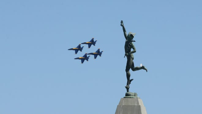 The Blue Angels practice over downtown Rochester for their show this weekend as part of theRochester International Airshow.