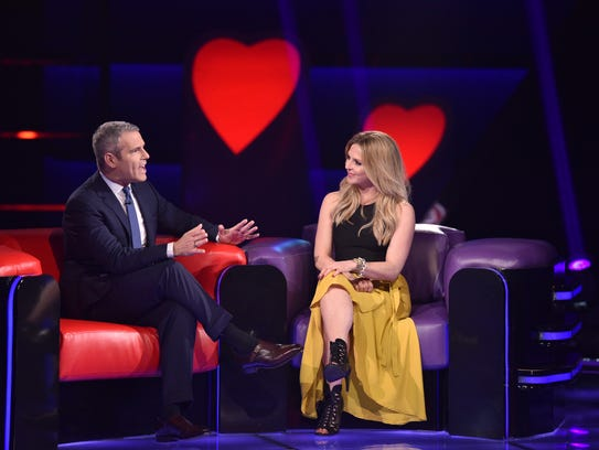 Host Andy Cohen talks to contestant Lauren Walsh on