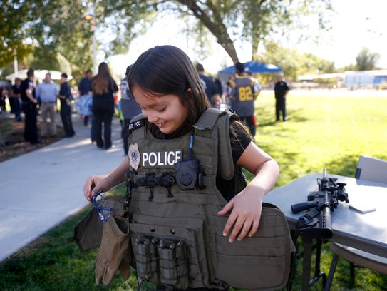 Blythe Kreitinger tries on a Farmington Police Department