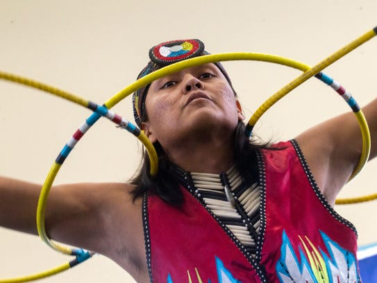 Joseph Secody performs a hoop dance Monday during Indigenous