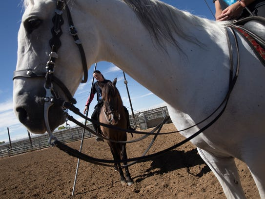 Christine Drentwett, at left, riding Coco Dos, and Mozart, ridden by Gigi Gasser, participate in a horsemanship demonstration on Wednesday at McGee Park in Farmington.