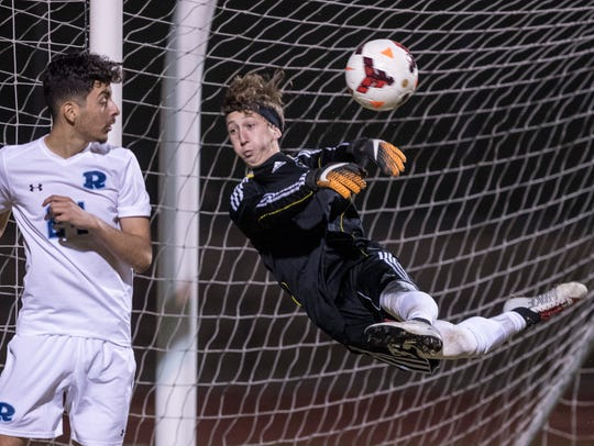 Redwood goalie Austin Garcia blocks a shot from Mt.