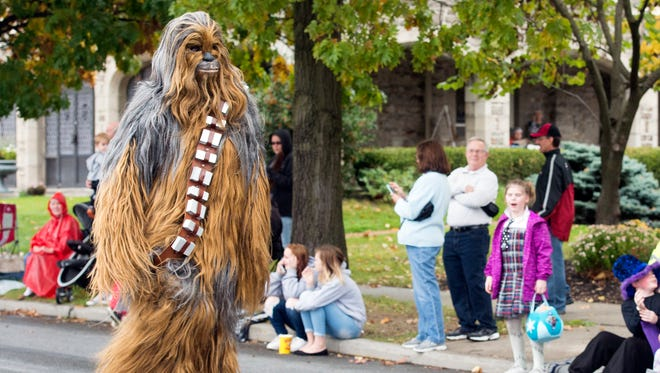 Chewbacca walks on to East Market Street during the 68th annual York Halloween Parade.