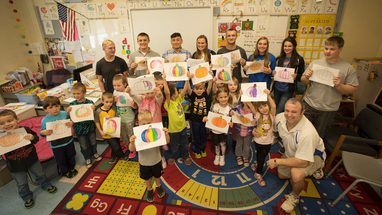 Northern Lebanon Viking athletes accompanied by wrestling coach Rusty Coach and girls basketball coach Ken Battistelli joined kindergarteners at Jonestown Elementary for a day of reading.