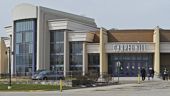 File photo: Patrons walk in the main entrance of Chapel Hill Mall in Akron.