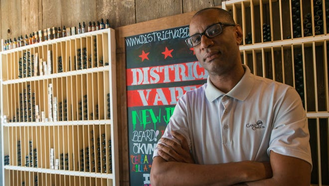 Sean Robinson, owner of District Vape, is concerned that new taxes and regulations will force him to close up shop.