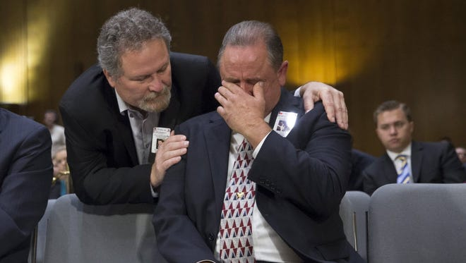 George Wilkerson, right, father of slain youth Josh Wilkerson of Pearland, Texas, is comforted by Don Rosenberg, father of Drew Rosenberg, who was killed by an unlicensed driver in the country illegally. The two testified on July 21, 2015, at a Senate Judiciary Committee hearing about how the administration's immigration enforcement policies have affected public safety.