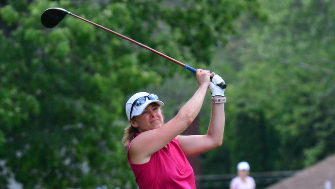 Joanna Beatty swings during the New York State Women's Mid-Amateur golf tournament in Elmira.