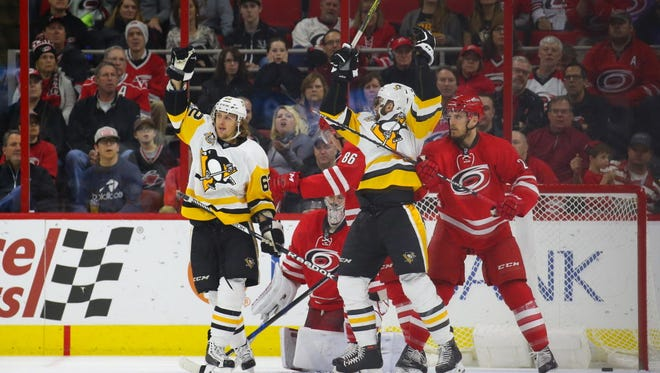 Penguins forward Carl Hagelin (62) celebrates his second-period goal against the Hurricanes.