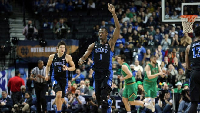 Duke forward Harry Giles reacts after a dunk against Notre Dame during the first half of the ACC title game.