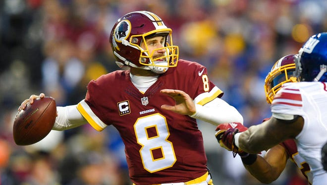 In this photo taken Jan. 1, 2017, Washington Redskins quarterback Kirk Cousins (8) passes during the first half of an NFL football game against the New York Giants in Landover, Md.