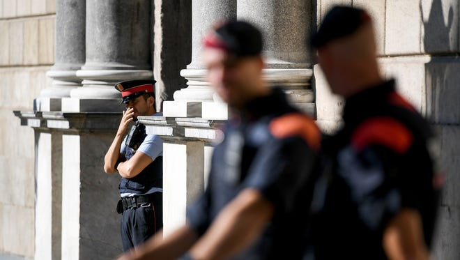 Police stand guard outside the Palau Catalan Regional Government Building, as Catalonia returns to work following last week's decision by the Catalan parliament to vote to split from Spain.