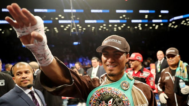 Mikey Garcia waves to the crowd after defeating Adrien Broner last July.