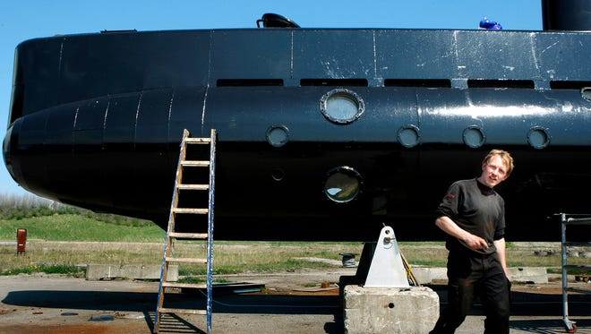 This April 30, 2008, file photo shows a submarine and its owner Peter Madsen.