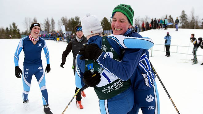 MMU's Aidan Burt, facing away, is congratulated by teammates, from left, Max Eriksson, Kai Richter and Samuel Leo after Burt anchored the Cougars winning relay team at the Vermont freestyle championship at Craftsbury Outdoor Center on Thursday, Feb. 22. (Photo by )