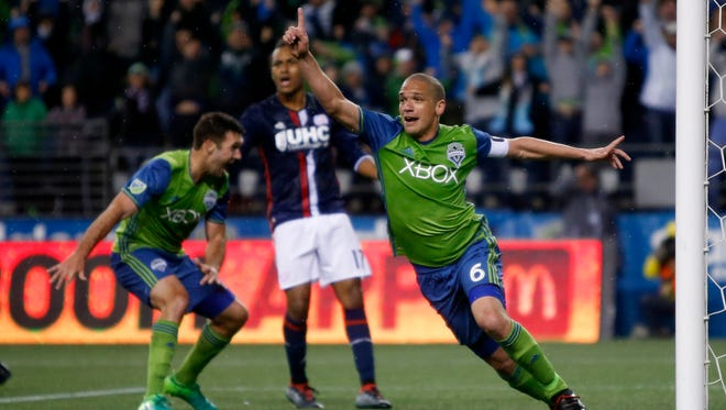The Seattle Sounders'  Osvaldo Alonso celebrates his game-tying goal against the New England Revolution.