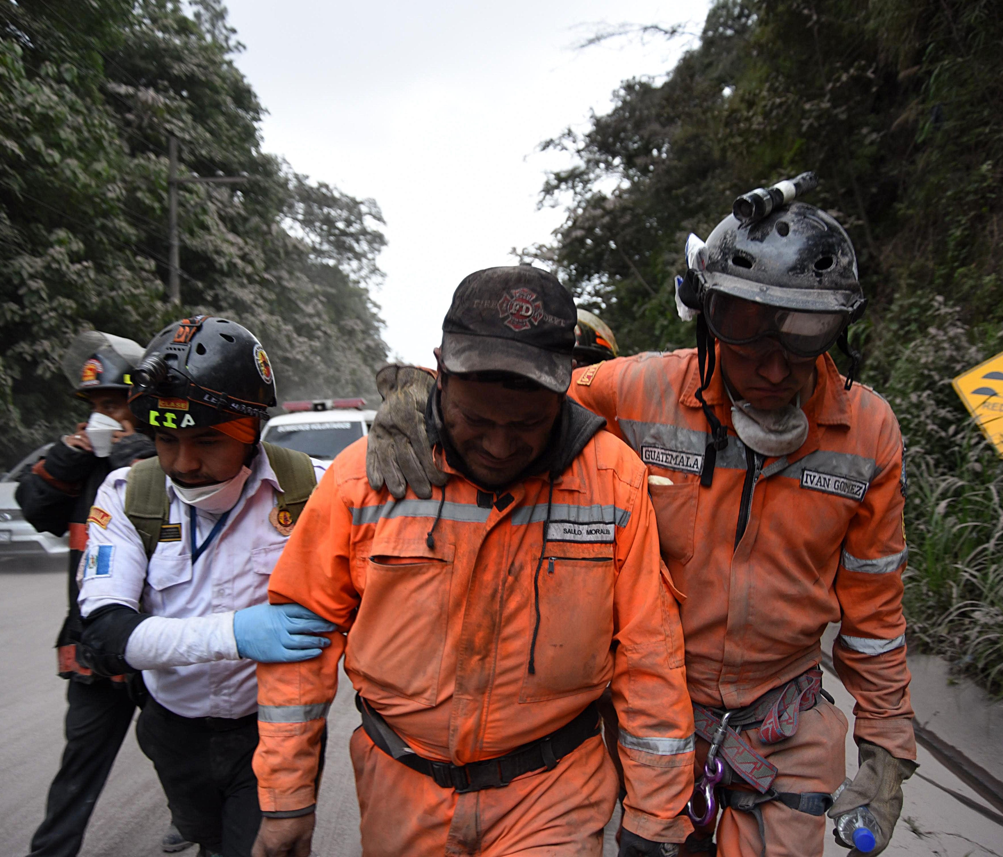 A volunteer firefighter cries after leaving El Rodeo village in Escuintla department, 35 km south of Guatemala City on June 3, 2018, following the eruption of the Fuego Volcano.
