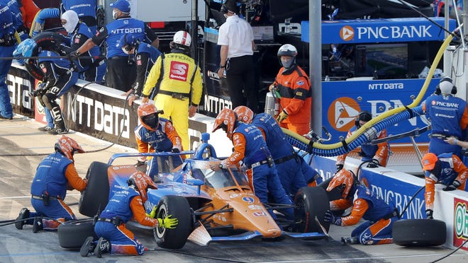 Scott Dixon has a change of tires and adjustments made to his car during a pit stop early the season-opening Genesys 300 at Texas Motor Speedway in Fort Worth Saturday. Dixon won the race, his fourth win at the track.